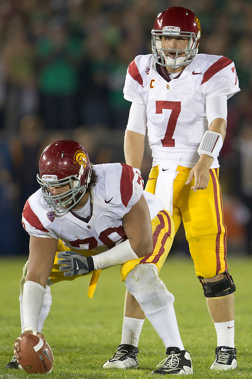 USC center Khaled Holmes (#78) and quarterback Matt Barkley (#7) during second quarter of NCAA football game between Notre Dame and USC.  The USC Trojans defeated the Notre Dame Fighting Irish 31-17 in game at Notre Dame Stadium in South Bend, Indiana.