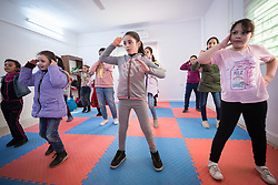 17 February 2020, Zarqa, Jordan: Zumba session for children at the Lutheran World Federation community centre in Zarqa. Through a variety of activities, the Lutheran World Federation community centre in Zarqa serves to offer psychosocial support and strengthen social cohesion between Syrian, Iraqi and other refugees in Jordan and their host communities.