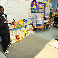 JaJuan reads a paper allowed in front of his class.