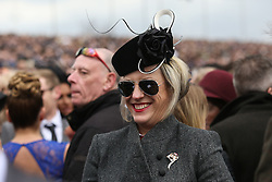 © Licensed to London News Pictures. 09/04/2016. Liverpool, UK. A elegant looking woman laughs with friends on Grand National day of the Grand National 2016 at Aintree Racecourse near Liverpool. The race, which was first run in 1839, is the most valuable jump race in Europe. Photo credit : Ian Hinchliffe/LNP