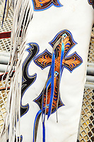 Crosses on a rider's chaps are a symbol of hope, or perhaps protection at the 2013 California Rodeo Salinas.