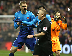 07 January 2018 FA Cup 3rd round Nottingham - Nottingham Forest v Arsenal - Per Mertesacker of Arsenal confronts referee Jonathan Moss after the second penalty for Forest as David Ospina complains to the linesman.<br /> (photo by Mark Leech)