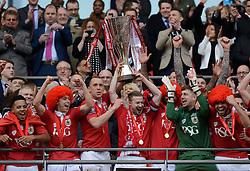 Bristol City's Aaron Wilbraham and Bristol City's Wade Elliott list the JPT trophy with fellow Bristol City players  - Photo mandatory by-line: Joe Meredith/JMP - Mobile: 07966 386802 - 22/03/2015 - SPORT - Football - London - Wembley Stadium - Bristol City v Walsall - Johnstone Paint Trophy Final