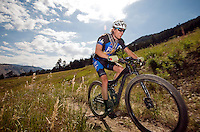 BRADLY J. BONER / NEWS&GUIDE <br /> Ben Aufderheide cruises along a downhill section of the Snow King mountain bike trail system on his way to a first-place finish in the Summit Singletrack on Saturday morning.