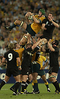 Photo: Richard Lane.<br />New Zealand v Australia. Semi-Final, at the Telstra Stadium, Sydney. RWC 2003. 15/11/2003. <br />Justin Harrison steals a lineout from Ali Williams.