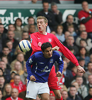 Photo: Andrew Unwin.<br />Liverpool v Everton. The Barclays Premiership. 25/03/2006.<br />Liverpool's Peter Crouch (top) competes with Everton's Tim Cahill (bottom).