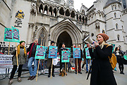 Demonstrators stage a protest opposing the governments plans for a third runway at Heathrow Airport outside the Royal Courts of Justice in London, UK on January 15, 2019. A pre-trial hearing challenging the legality of the government's decision takes place today with campaigners claiming the decision is unlawful as it ignores climate impact.
