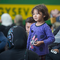 Illegal migrant girl on the platform as their family waits to board a train in hopes to leave for Germany at the main railway station Keleti in Budapest, Hungary on September 03, 2015. ATTILA VOLGYI