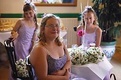 Bridesmaids sitting around table at wedding reception,