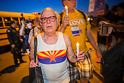"23 JUNE 2012 - PHOENIX, AZ:   Members of the Unitarian Church march past the Maricopa County Jail in Phoenix. About 2,000 members of the Unitarian Universalist Church, in Phoenix for their national convention, picketed the entrances to the Maricopa County Jail and ""Tent City"" Saturday night. They were opposed to the treatment of prisoners in the jail, many of whom are not convicted and are awaiting trial, and Maricopa County Sheriff Joe Arpaio's stand on illegal immigration. The protesters carried candles and sang hymns.     PHOTO BY JACK KURTZ"