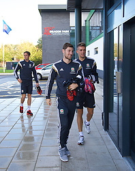 NEWPORT, WALES - Tuesday, October 7, 2014: Wales' Ben Davies and Emyr Huws arrive for training at Dragon Park National Football Development Centre ahead of the UEFA Euro 2016 qualifying match against Bosnia and Herzegovina. (Pic by David Rawcliffe/Propaganda)