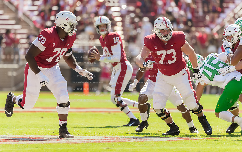 PALO ALTO, CA - OCTOBER 2:  Myles Hinton #78 and Jake Hornibrook #73 of the Stanford Cardinal offensive line block for quarterback Tanner McKee #18 during an NCAA Pac-12 college football game against the Oregon Ducks on October 2, 2021 at Stanford Stadium in Palo Alto, California.  (Photo by David Madison/Getty Images)