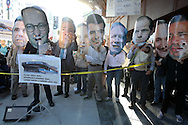 Prior to the Barclays Center ribbon cutting, Brooklyn community organizations gather for  for an alternate ribbon cutting ceremony and press conference.<br /> Wearing giant paper masks of Mayor Bloomberg, Governor Andrew  Cuomo, Borough President  Marty Markowitz, Bruce Ratner, Mikhail Prokhorov, former Governors George Pataki, Elliot Spitzer David Patterson  <br /> and Senator Chuck Schumer<br /> this press conference  is  intended to highlight the troubled history of the Barclays Center and Atlantic Yards project and the unfulfilled promises, of affordable housing and local jobs. (Sept.21, 2012)