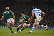 Ireland's Ian Madigan © looks for a gap.  Rugby World Cup 2015 quarter-final match, Ireland v Argentina at the Millennium Stadium in Cardiff, South Wales  on Sunday 18th October 2015.<br /> pic by  Andrew Orchard, Andrew Orchard sports photography.