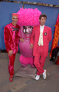 Andrew Logan and Duggie Fields, Opening party, Zandra Rhodes Museum fashion and textiles. Bermondsey St. 8 May 2003. © Copyright Photograph by Dafydd Jones 66 Stockwell Park Rd. London SW9 0DA Tel 020 7733 0108 www.dafjones.com