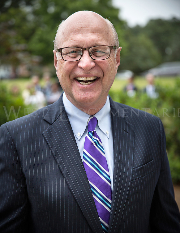 Harvey Schmitt, former president and CEO of the Greater Raleigh Chamber of Commerce, poses for a portrait at the Merz ribbon cutting ceremony on June 5.