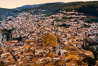 High angle view down on the hill top village of Montefrio, Granada Province, Andalusia, Spain featuring the oval Church of La Encarnacion, which was modeled on the Pantheon in Rome, Italy. Montefrio was called one of the top ten towns with the best views in the world by National Geographic.