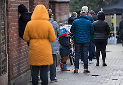 © Licensed to London News Pictures. 02/02/2021. London, UK. Member of the public queue to enter a new Variant Testing Centre in Ealing, West London, set up after the discovery of a new South African variant of coronavirus. Door-to-door delivery of free home test kits is to start in the area in an attempt to slow the spread of the more aggressive strain of the virus. Photo credit: Ben Cawthra/LNP