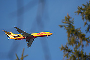 Yellow DHL cargo plane in flight
