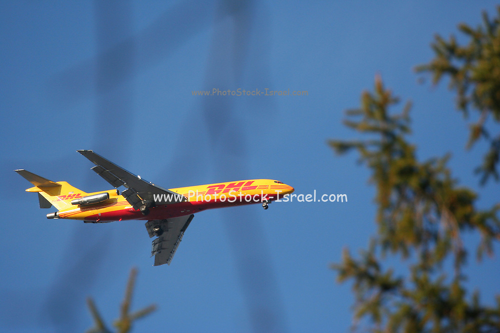 Yellow DHL cargo plane in flight