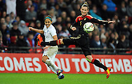 Alex Scott of England Women is challenged by Simone Laudehr of Germany Women<br /> - Womens International Football - England vs Germany - Wembley Stadium - London, England - 23rdNovember 2014  - Picture Robin Parker/Sportimage