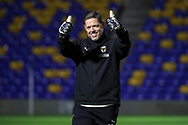 AFC Wimbledon goalkeeping coach Ashley Bayes giving thumbs up prior to kick off during the EFL Sky Bet League 1 match between AFC Wimbledon and Peterborough United at Plough Lane, London, United Kingdom on 2 December 2020.