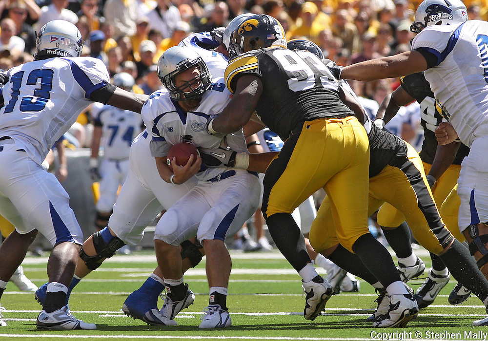 September 4 2010: Eastern Illinois Panthers running back Jimmy Potempa (2) is hit by Iowa Hawkeyes defensive tackle Karl Klug (95) and Iowa Hawkeyes defensive tackle Mike Daniels (93) during the fourth quarter of the NCAA football game between the Eastern Illinois Panthers and the Iowa Hawkeyes at Kinnick Stadium in Iowa City, Iowa on Saturday September 4, 2010. Iowa defeated Eastern Illinois 37-7.