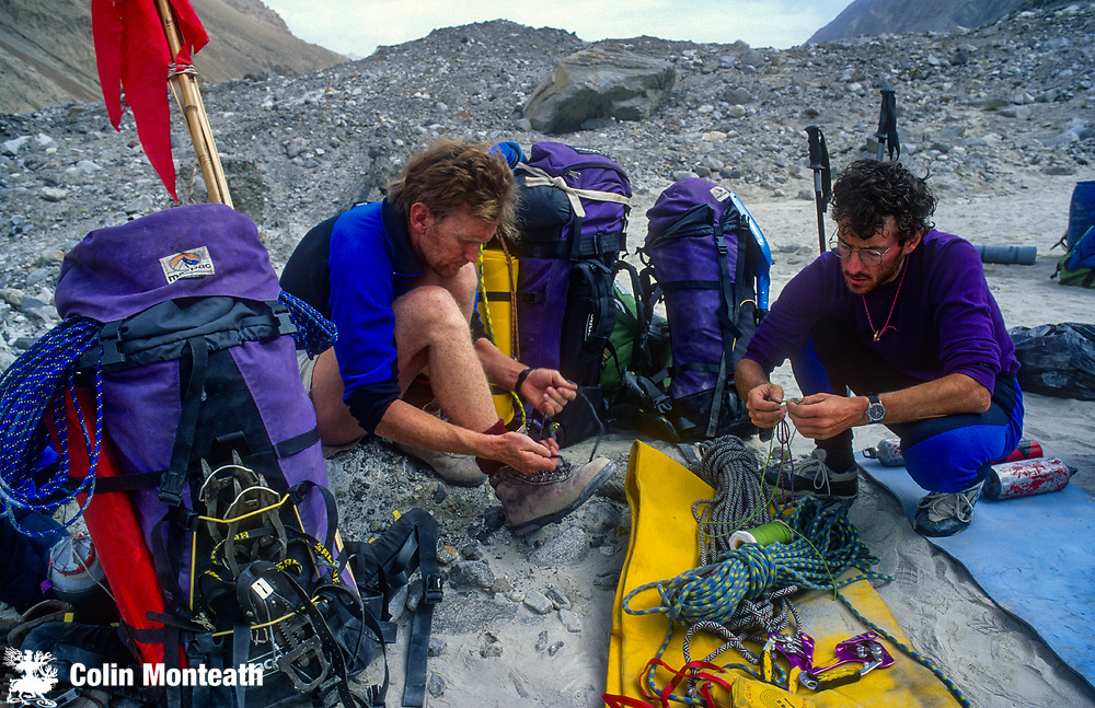 Climbers prepare gear base camp  on 7300m peak 1st ascent Chongtar, Karakoram Mts, far western China, Central Asia
