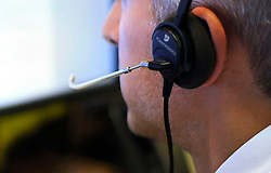 PICTURE POSED BY MODEL File photo dated 04/08/15 of an office worker on the phone as a last-ditch legal challenge to the controversial appointment of a G4S company to run a national helpline for people who may be victims of discrimination has been rejected by the High Court.