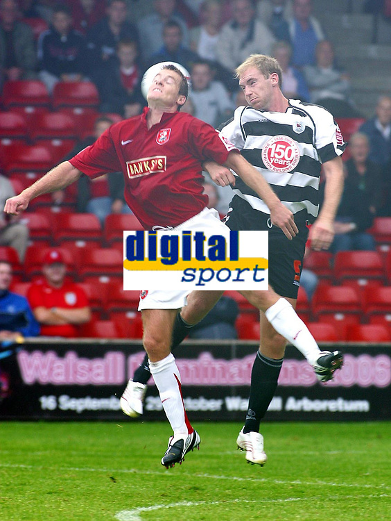 Photo: Dave Linney.<br />Walsall v Darlington. Coca Cola League 2. Coca Cola League 2. 26/08/2006.Walsall's Martin Butler(L) rises for the ball with  Patrick Collins