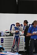 Sakon Yamamoto talking to his engineer before the race during the FIA Formula E Visa London ePrix  at Battersea Park, London, United Kingdom on 28 June 2015. Photo by Matthew Redman.