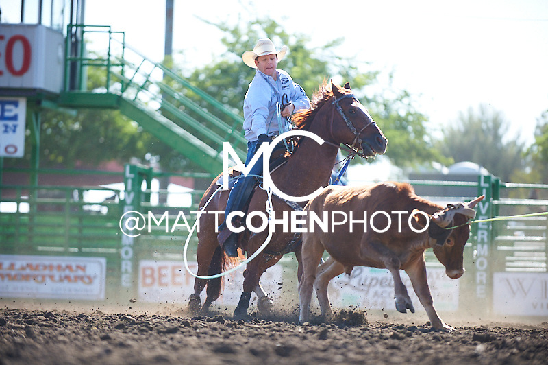 Team roper Jim Ross Cooper of Monument, NV competes at the Livermore Rodeo in Livermore, CA<br /> <br /> <br /> UNEDITED LOW-RES PREVIEW<br /> <br /> <br /> File shown may be an unedited low resolution version used as a proof only. All prints are 100% guaranteed for quality. Sizes 8x10+ come with a version for personal social media. I am currently not selling downloads for commercial/brand use.
