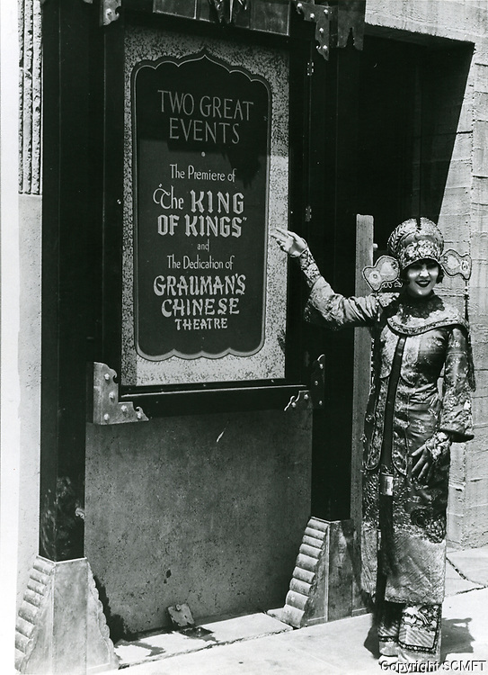 1927 Usher points to a poster announcing the movie premiere of King Of Kings at Grauman's Chinese Theater