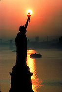 Statue of Liberty National Monument, New York City, New  York, New Jersey, Aerial, golden streak with sun