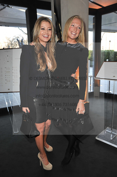Left to right, HOLLY VALANCE and EMILY CANDY at the launch of One Hyde Park, The Residences at Mandarin Oriental, Knightsbridge, London on 19th January 2011.