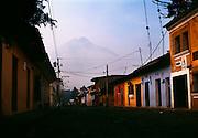 Antigua, Guatemala city Street with view of volcano Agua.
