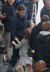 """Day two of filming. Brad Pitt plays with one of his co-stars on the set of the movie """"World War Z"""" being shot in the city centre of Glasgow. The film, which is set in Philadelphia, is being shot in various parts of Glasgow, transforming it to shoot the post apocalyptic zombie film.."""