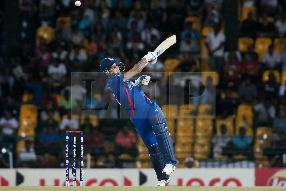 © Licensed to London News Pictures. 23/09/2012. England batsmen Jade Dernbach plays a shot one handed during the T20 Cricket World T20 match between England Vs India at the R.Premadasa Cricket Stadium,Colombo. Photo credit : Asanka Brendon Ratnayake/LNP