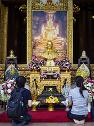 January 3, 2018 - Bangkok, Thailand - People pray at a shrine for Bhumibol Adulyadej, the Late King of Thailand, at Wat Bowonniwet.  It is where the Late King Bhumibol and his son, the present King Vajiralongkorn were monks. Hundreds of people visit the temple every to pray for the late King, who died in October 2015 and was cremated in October 2016. Some of the revered King's ashes are interred at the temple. (Credit Image: © Sean Edison via ZUMA Wire)
