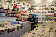 A man searching though vinyl records at Rolling Records in West Wickham on the 4th May 2018 in South London in the United Kingdom.