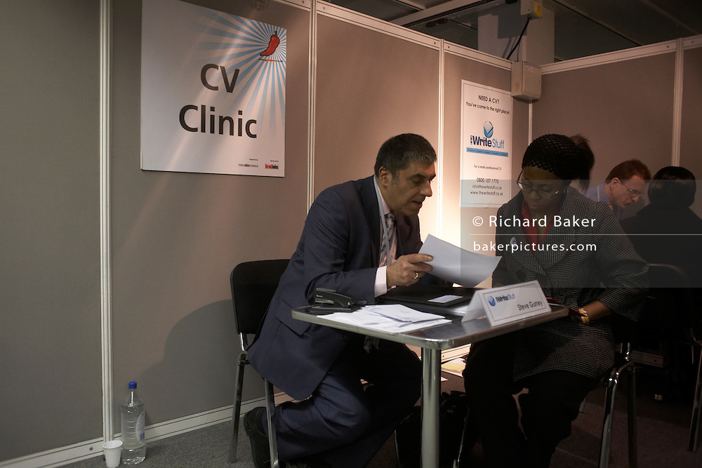 receiving advice from a CV clinic at a graduate expo fair where company job recruiters meet young people starting work