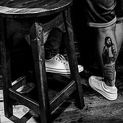 """A tattoo of Bobby Sands, who at 27 died from a hunger strike, during """"The Troubles"""" can be seen at the Castle Bar, known as an IRA hangout during """"Rebel Sundays"""" on Waterloo Street. Northern Ireland, September 2019"""