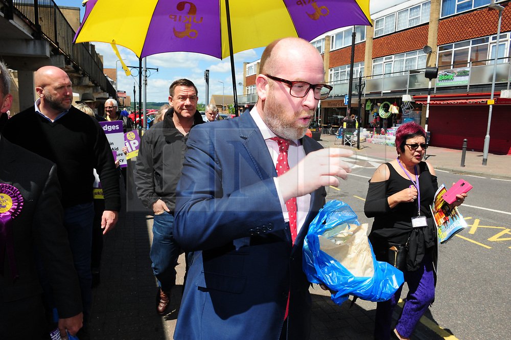 © Licensed to London News Pictures. 07/06/2017<br /> Paul Nuttall eating a bag of white seedless grapes on walk about with PETER WHITTLE UKIP Candidate for South Basildon and East Thurrock.<br /> UKIP Leader Paul Nuttall in Corrington,Essex this afternoon on a walkabout on the last day of the election campaign for 2017.<br /> Photo credit: Grant Falvey/LNP