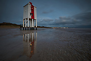 The Low Light at Burnham on Sea is a unique wooden lighthouse on piles sunk deep into the shifting sands of Burnham Beach. Originally part of a two light alignment, the Low Light, a listed building, now displays a sectored light to guide boats safely through the sandbars.