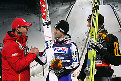 Austria's head coach Alexander Pointner (L) congratulates to winner Wolfgang Loitzl (C) and second placed compatriot Gregor Schlierenzauer (R) after the men's HS 100 ski jumping competition  at FIS Nordic World Ski Championships Liberec 2008, on February 21, 2009, in Jested, Liberec, Czech Republic. (Photo by Vid Ponikvar / Sportida)
