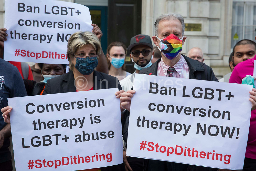 Jayne Ozanne of the Ban Conversion Therapy Coalition l and veteran LGBT+ and human rights campaigner Peter Tatchell r attend a picket in protest against LGBT+ conversion therapy outside the Cabinet Office and Government Equalities Office on 23rd June 2021 in London, United Kingdom. They also handed in a petition signed by 7,500 people calling on the government to fulfil its promise made in July 2018 to ban the practice. LGBT+ conversion treatments, which have been linked to anxiety, depression and self-harm, have been condemned by major UK medical, psychological and counselling organisations.