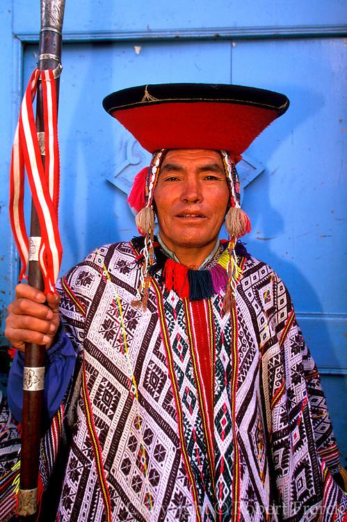 PERU, HIGHLANDS, MARKETS Pisac; village elder with staff