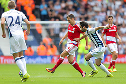 Jordan Rhodes of Middlesbrough is challenged by Claudio Yacob of West Bromwich Albion - Rogan Thomson/JMP - 28/08/2016 - FOOTBALL - The Hawthornes - West Bromwich, England - West Bromwich Albion v Middlesbrough - Premier League.