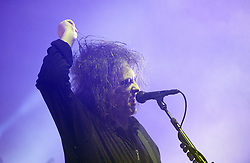 © London News Pictures. 24/08/2012. London, UK. The Cure performing  on the Main stage on day one of Reading Festival 2012 in Reading, Berkshire, UK on August 24, 2012. The three day event which attracts over 80,000 music fans opens officially today (Friday) and will headline The Cure, Kasabian and The Foo Fighters Photo credit : Ben Cawthra/LNP