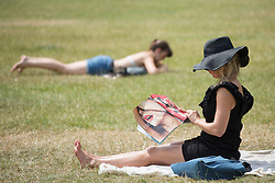 © licensed to London News Pictures. London, UK 16/07/2013. People enjoying the sunshine and hot weather in Green Park, London on Tuesday, 16 July 2013. Photo credit: Tolga Akmen/LNP